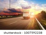 white box truck driving fast on ... | Shutterstock . vector #1007592238