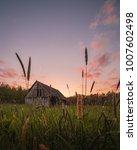 sunset behind an abandoned barn | Shutterstock . vector #1007602498