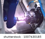 close up robot hands in milling ... | Shutterstock . vector #1007630185