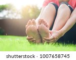 foot pain .woman sitting on... | Shutterstock . vector #1007658745