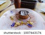 tiramisu cake on the plate  ...   Shutterstock . vector #1007663176