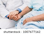 doctor holding elderly person... | Shutterstock . vector #1007677162