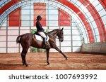 a sweet girl jockey rides a...   Shutterstock . vector #1007693992
