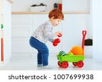 cute redhead toddler baby... | Shutterstock . vector #1007699938