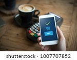 hand and mobile payment in... | Shutterstock . vector #1007707852