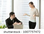 Small photo of Company leader pointing on wrist watch when asking female employee about delay in project, fail deadline, deviation from schedule, late for work. Woman making excuses because of absence from work