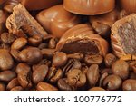 Assorted chocolate candies and coffee beans background - stock photo