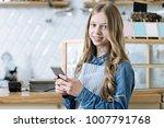 pose on camera. pretty waiter... | Shutterstock . vector #1007791768
