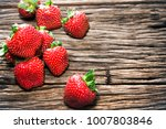 red strawberry fruits and... | Shutterstock . vector #1007803846