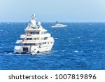 Small photo of Daylight close-up view to white yachts with people on board cruising on water isolated. Bright blue clear sky. Negative copy space, place for text. Cap d'Ail, france