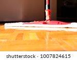 cleaning floor in room close up | Shutterstock . vector #1007824615