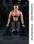 Small photo of Man training abdominal muscles in the fitness room.