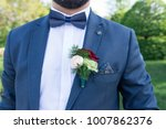 boutonniere on the suit jacket... | Shutterstock . vector #1007862376