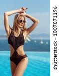 young model girl in black... | Shutterstock . vector #1007871196
