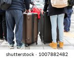close up the tourist and bag in ...   Shutterstock . vector #1007882482