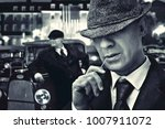 Small photo of vintage bossy Italian mafia gangsters in 1930's near classic car