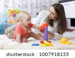 little baby boy and his mommy... | Shutterstock . vector #1007918155