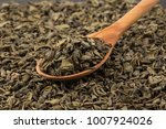 gunpowder green tea in spoon... | Shutterstock . vector #1007924026