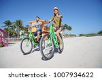 couple of tourists riding bike... | Shutterstock . vector #1007934622