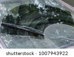 dirty car window with a wiper... | Shutterstock . vector #1007943922