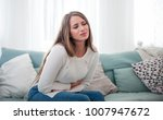young woman suffering from... | Shutterstock . vector #1007947672