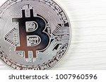 bitcoin coin on wooden...   Shutterstock . vector #1007960596