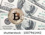 golden bitcoin coin on dollars. ...   Shutterstock . vector #1007961442