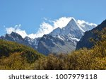 triangle snowy mountain peak in ... | Shutterstock . vector #1007979118