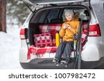 young girl skier sitting in car ... | Shutterstock . vector #1007982472