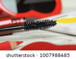 brush of black mascara and  red ... | Shutterstock . vector #1007988685