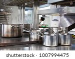 pans in a professional kitchen | Shutterstock . vector #1007994475