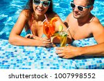 young couple are relaxing at... | Shutterstock . vector #1007998552