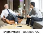 two business people conversing... | Shutterstock . vector #1008008722