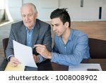 financial advisor explaining... | Shutterstock . vector #1008008902