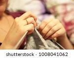 woman knits with knitting...   Shutterstock . vector #1008041062