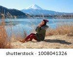 girl sitting near the fuji...   Shutterstock . vector #1008041326