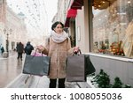 girl with packages goes down...   Shutterstock . vector #1008055036