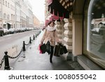 girl with packages goes down... | Shutterstock . vector #1008055042