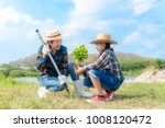 asian mom and child girl plant... | Shutterstock . vector #1008120472