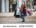 cute little girl on shopping.... | Shutterstock . vector #1008150982