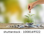 hand holding putting coin into... | Shutterstock . vector #1008169522