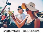 young hipster couple using... | Shutterstock . vector #1008185326