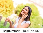 a cheerful young woman in a... | Shutterstock . vector #1008196432