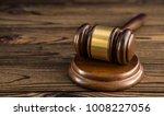 hammer of judge on a wooden... | Shutterstock . vector #1008227056