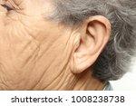 elderly woman  closeup of ear.... | Shutterstock . vector #1008238738