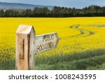 wooden public footpath sign...