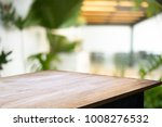 empty wood desk over blurred... | Shutterstock . vector #1008276532