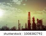 oil refinery at sunset   Shutterstock . vector #1008382792