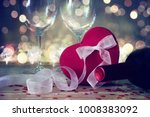 the red heart shapes gift box... | Shutterstock . vector #1008383092