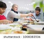 family gathering eating dinner...   Shutterstock . vector #1008383536
